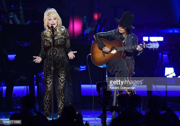 Honoree Dolly Parton and Linda Perry perform onstage during MusiCares Person of the Year honoring Dolly Parton at Los Angeles Convention Center on...