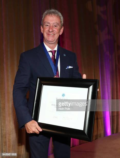 Honoree Douglas Maclagan poses for a photo on stage at the 2018 Crisis Award at the 2018 World of Children Hero Awards Benefit at Montage Beverly...