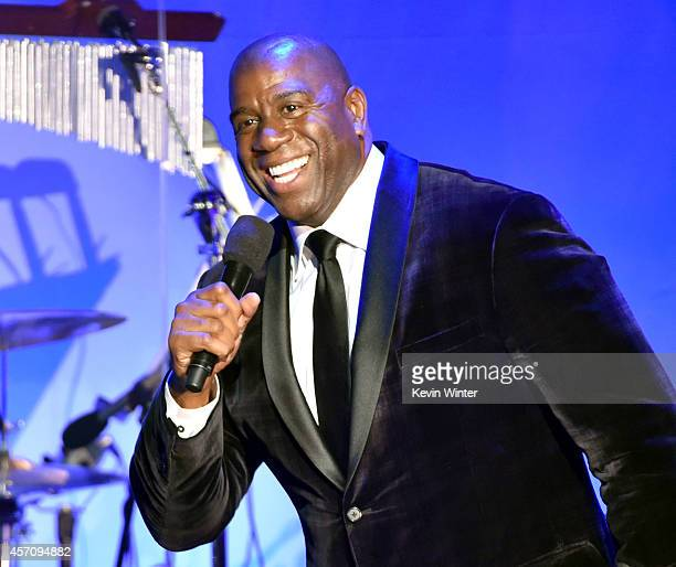 Honoree Earvin 'Magic' Johnson speaks onstage at the 2014 Carousel of Hope Ball presented by MercedesBenz at The Beverly Hilton Hotel on October 11...