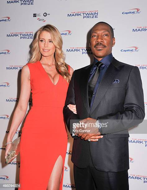 Honoree Eddie Murphy and Paige Butcher pose on the red carpet during the 18th Annual Mark Twain Prize For Humor at The John F Kennedy Center for...