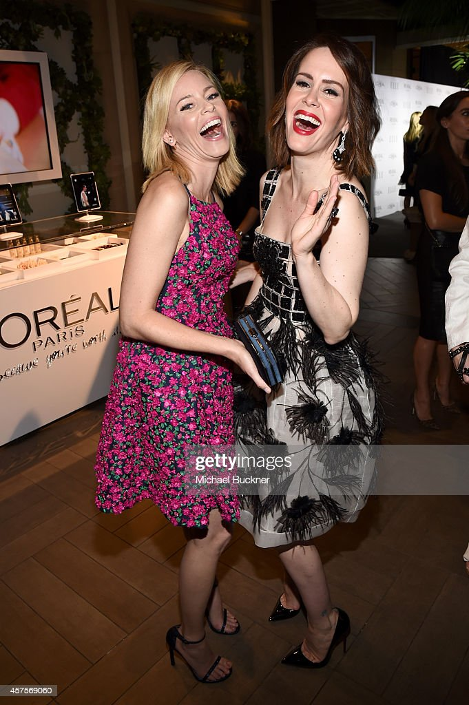 Honoree Elizabeth Banks (L) and actress Sarah Paulson attend ELLE's 21st Annual Women in Hollywood Celebration at the Four Seasons Hotel on October 20, 2014 in Beverly Hills, California.