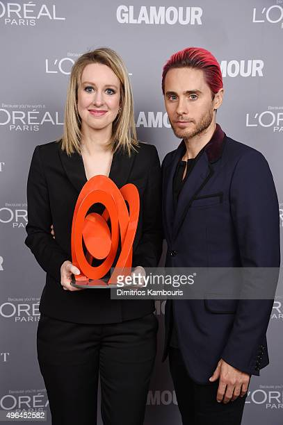 Honoree Elizabeth Holmes poses backstage with her award and actor Jared Leto at the 2015 Glamour Women Of The Year Awards at Carnegie Hall on...