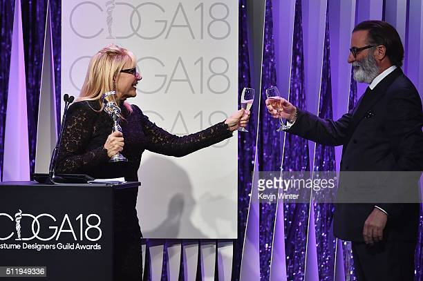 Honoree Ellen Mirojnick recipient of the Career Achievement Award and actor Andy Garcia toast onstage during the 18th Costume Designers Guild Awards...
