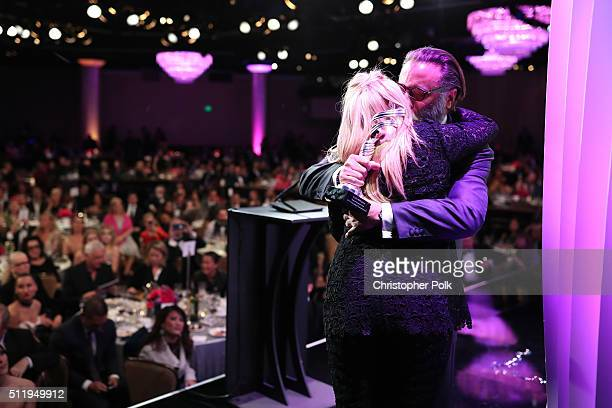 Honoree Ellen Mirojnick recipient of the Career Achievement Award and actor Andy Garcia embrace onstage during the 18th Costume Designers Guild...