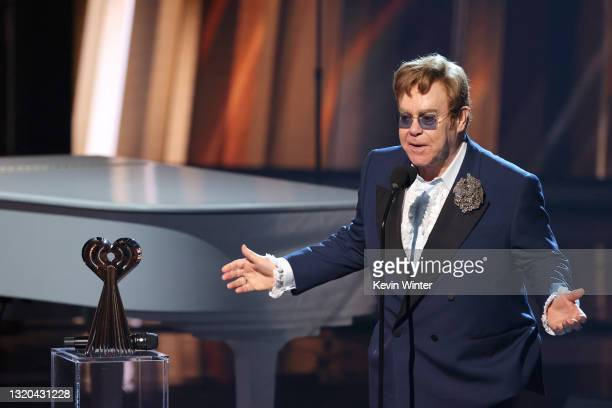 Honoree Elton John accepts the iHeartRadio Icon Award onstage at the 2021 iHeartRadio Music Awards at The Dolby Theatre in Los Angeles, California,...