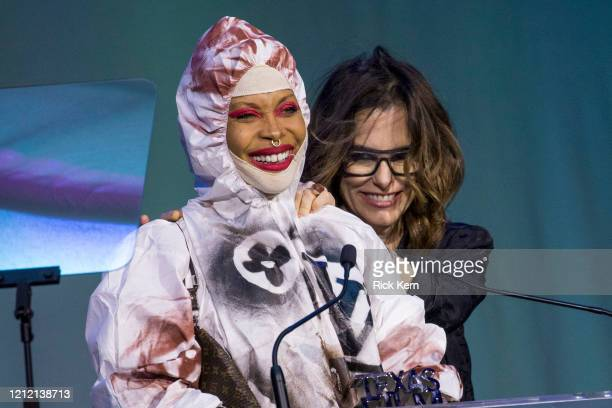 Honoree Erykah Badu accepts an award with host Parker Posey at the Austin Film Society's Texas Film Awards 20th Anniversary at Austin Studios on...