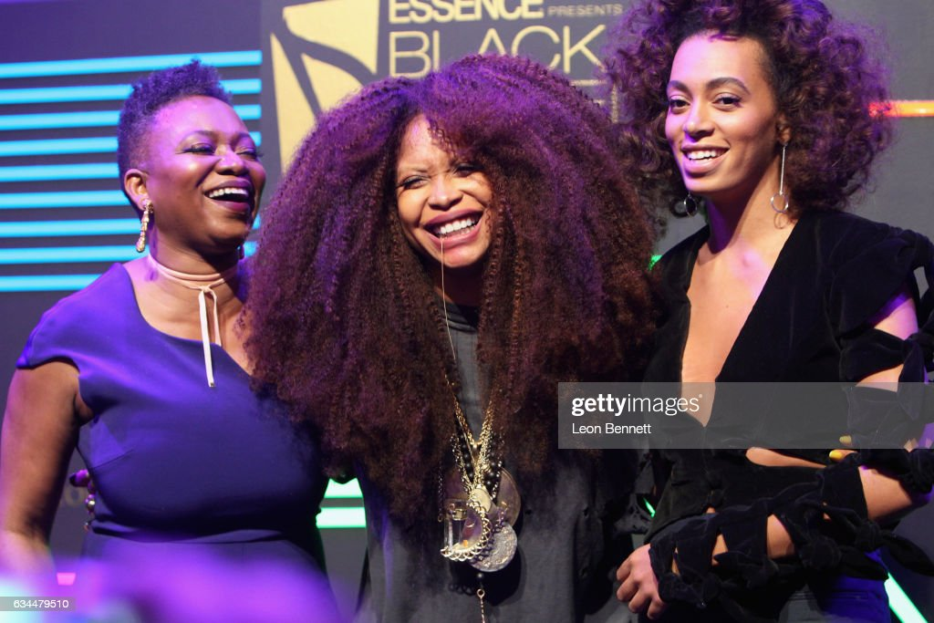 Honoree Erykah Badu accepts award (C) from Essence editor-in-chief Vanessa DeLuca and recording artist Solange Knowles onstage during 2017 Essence Black Women in Music at NeueHouse Hollywood on February 9, 2017 in Los Angeles, California.