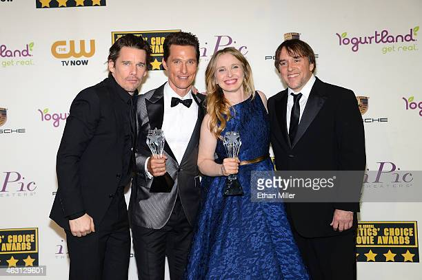 Honoree Ethan Hawke actor Matthew McConaughey honoree Julie Delpy and honoree Richard Linklater pose with the Louis XIII Genius Award in the press...