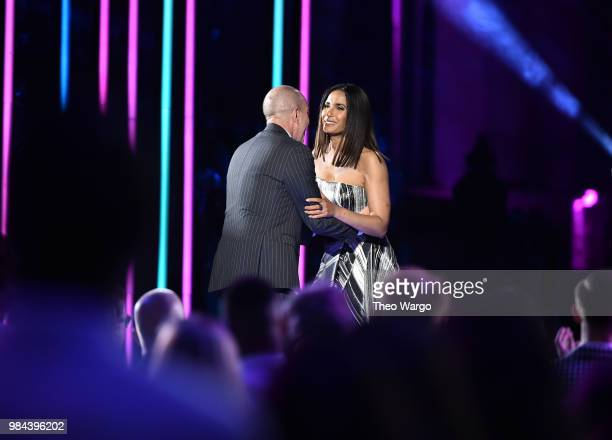 Honoree Executive Director of the American Civil Liberties Union Anthony D Romero accepts his award from Presenter author Padma Lakshmi on stage...