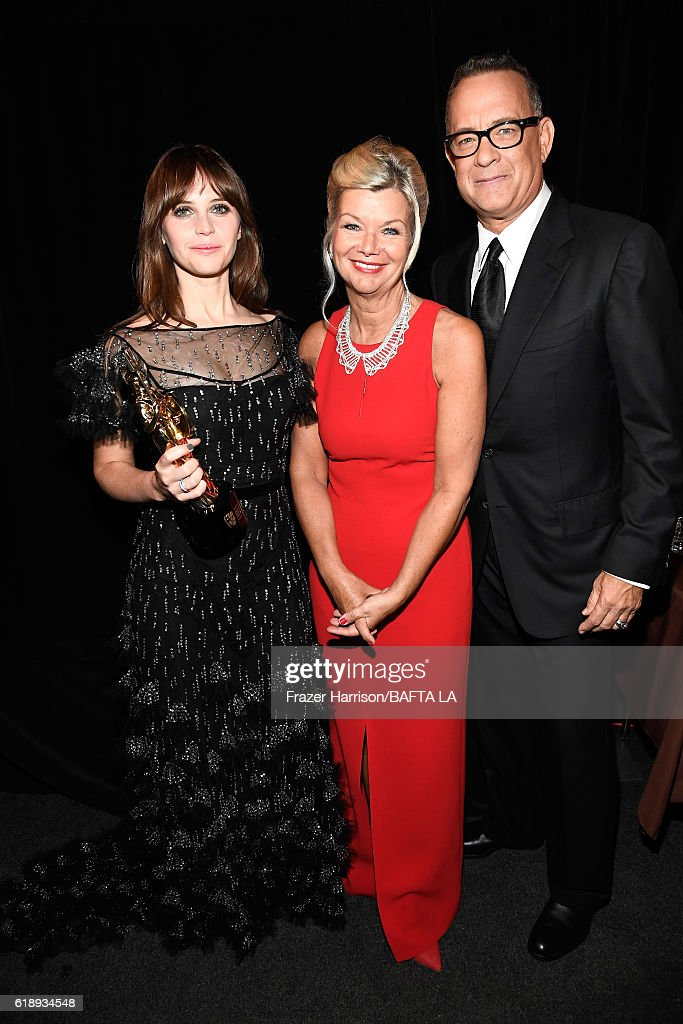 Honoree Felicity Jones, recipient of the British Artist of the Year presented by Burberry, BAFTA LA CEO Chantal Rickards, and actor Tom Hanks pose during the 2016 AMD British Academy Britannia Awards presented by Jaguar Land Rover and American Airlines at The Beverly Hilton Hotel on October 28, 2016 in Beverly Hills, California.