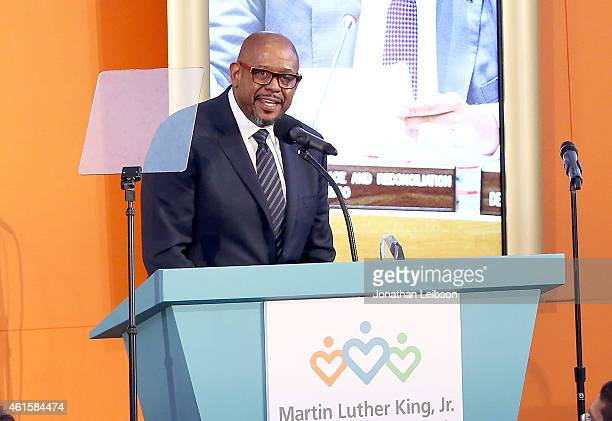 """Honoree Forest Whitaker accepts the Community Engagement Award onstage during MLK """"Celebrating The Dream"""" luncheon at Dorothy Chandler Pavilion on..."""