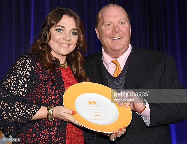 Honoree Francesca Lavazza of Lavazza is presented with her award from Chef Mario Batali on stage at the Food Bank Of New York City's Can Do Awards...