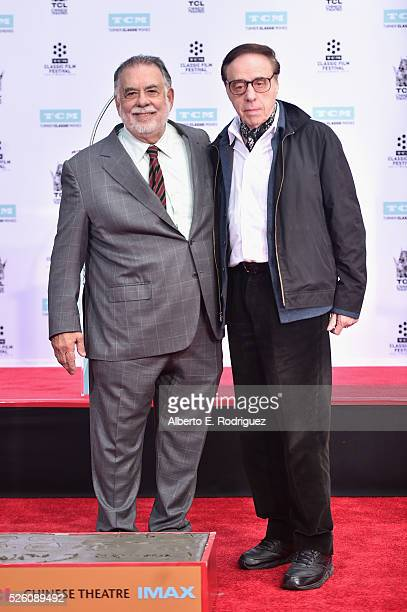 Honoree Francis Ford Coppola and writer/director Peter Bogdanovich attend the Francis Ford Coppola Hand and Footprint Ceremony during the TCM Classic...