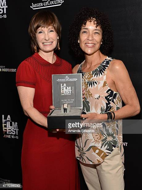 Honoree Gale Anne Hurd and LA Film Festival Director Stephanie Allain pose with the Glory To The Filmmaker award at Women Who Make It Happen: Gale...
