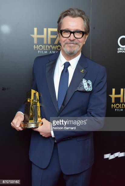 Honoree Gary Oldman recipient of the Hollywood Career Achievement Award poses in the press room during the 21st Annual Hollywood Film Awards at The...