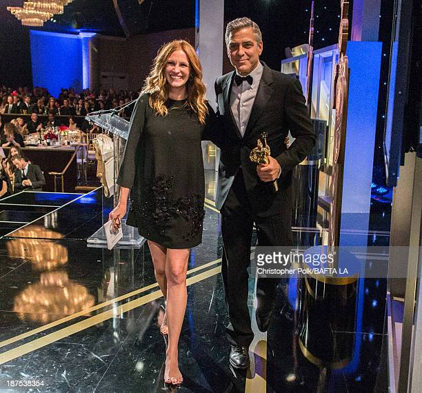 Honoree George Clooney recipient of the Stanley Kubrick Britannia Award for Excellence in Film and actress Julia Roberts walk off stage during the...