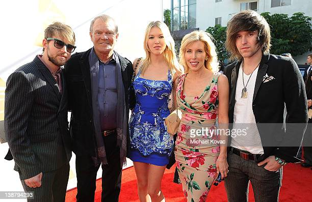 Honoree Glen Campbell and wife Kim Campbell and their family arrive at The 54th Annual GRAMMY Awards Special Merit Awards Ceremony and Nominee...