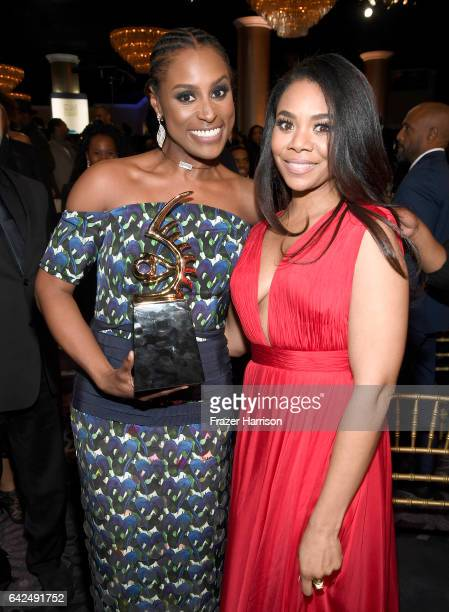 Honoree Issa Rae and host Regina Hall pose with the Rising Star Award during BET Presents the American Black Film Festival Honors on February 17 2017...