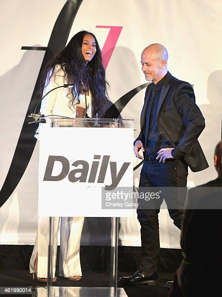Honoree Italo Zucchelli accepts the award for Calvin Klein Collection for Menswear Designer of the Year from recording artist Ciara during The DAILY...