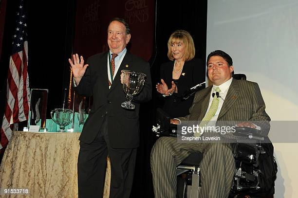 Honoree Jack Schneider Carol Rahr and President of The Miami Project and The Buoniconti Fund to Cure Paralysis Marc Buoniconti speak onstage during...