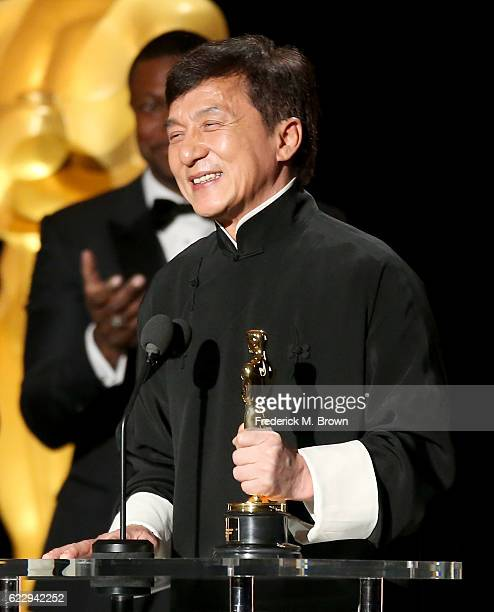 Honoree Jackie Chan accepts an award onstage during the Academy of Motion Picture Arts and Sciences' 8th annual Governors Awards at The Ray Dolby...