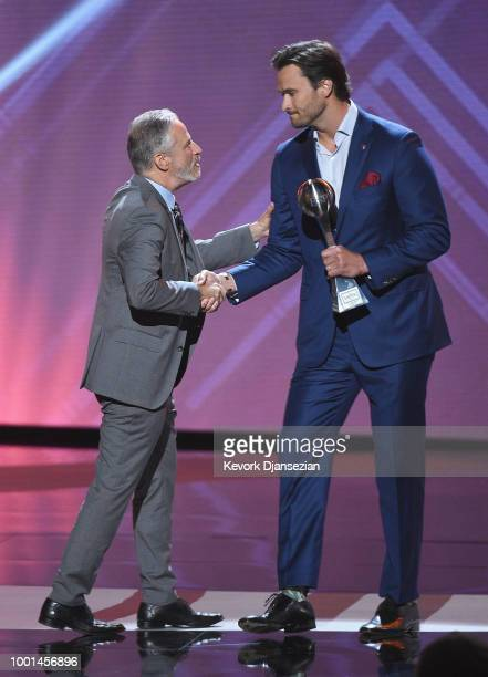 Honoree Jake Wood accepts the Pat Tillman Award for Service from Jon Stewart onstage during The 2018 ESPYS at Microsoft Theater on July 18 2018 in...