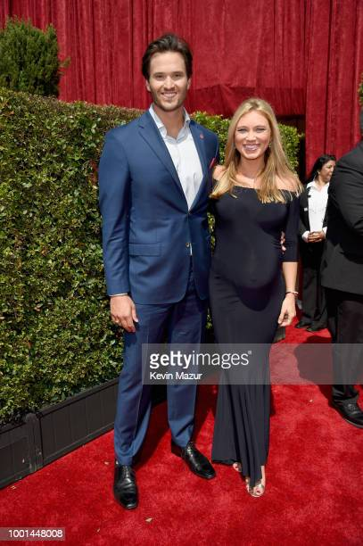 Honoree Jake Woods and TV meteorologist Indra Petersons attend the The 2018 ESPYS at Microsoft Theater on July 18 2018 in Los Angeles California