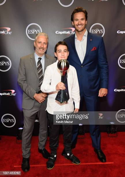 Honoree Jake Woods poses with his Pat Tillman Award and comedian Jon Stewart at The 2018 ESPYS at Microsoft Theater on July 18 2018 in Los Angeles...