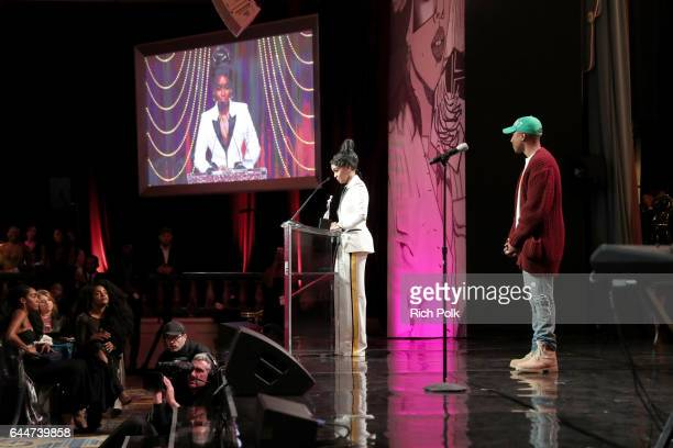 Honoree Janelle Monae accepts the 'Breakthrough Award' from Pharrell Williams onstage at Essence Black Women in Hollywood Awards at the Beverly...
