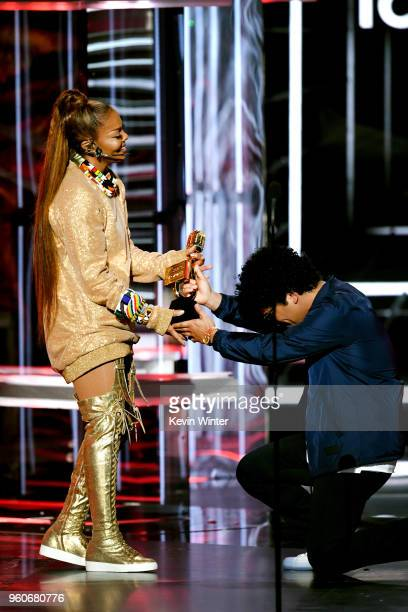 Honoree Janet Jackson accepts the Icon Award from recording artist Bruno Mars onstage during the 2018 Billboard Music Awards at MGM Grand Garden...