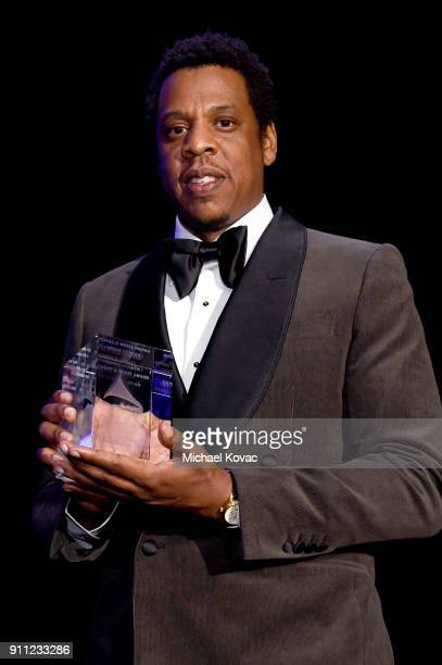 Honoree JayZ accepts the President's Merit Award onstage during the Clive Davis and Recording Academy PreGRAMMY Gala and GRAMMY Salute to Industry...