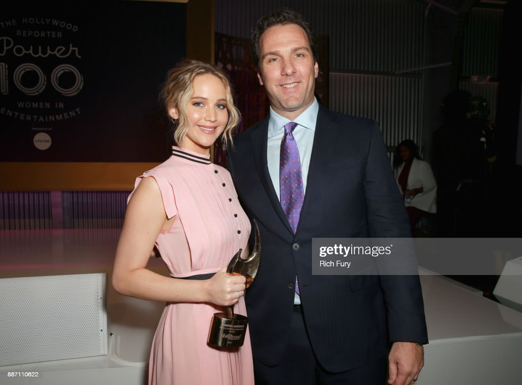 Honoree Jennifer Lawrence (L) and THR Editorial Director Matthew Belloni pose with The Sherry Lansing Leadership Award during The Hollywood Reporter's 2017 Women In Entertainment Breakfast at Milk Studios on December 6, 2017 in Los Angeles, California.