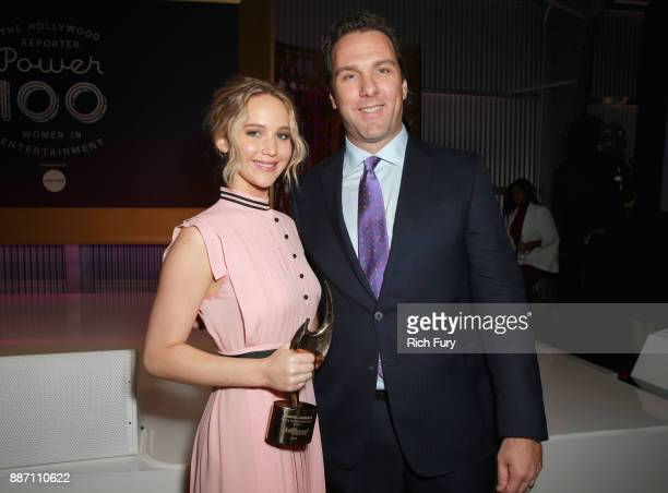 Honoree Jennifer Lawrence and THR Editorial Director Matthew Belloni pose with The Sherry Lansing Leadership Award during The Hollywood Reporter's...