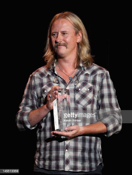 Honoree Jerry Cantrell of Alice In Chains poses with the Stevie Ray Vaughn Award onstage during the 8th Annual MusiCares MAP Fund Benefit at Club...