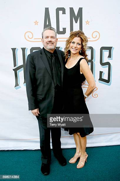Honoree Jimmy Webb and Laura Savini attend the 10th Annual ACM Honors at the Ryman Auditorium on August 30 2016 in Nashville Tennessee