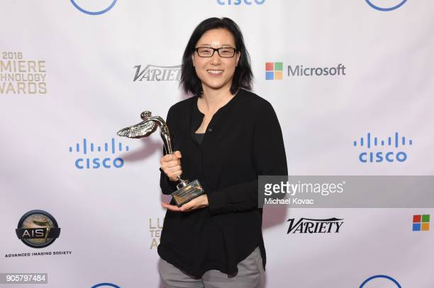 Honoree JoAnne Kim poses with the Distinguished Leadership Award at the Advanced Imaging Society 2018 Lumiere Technology Awards Featuring The...
