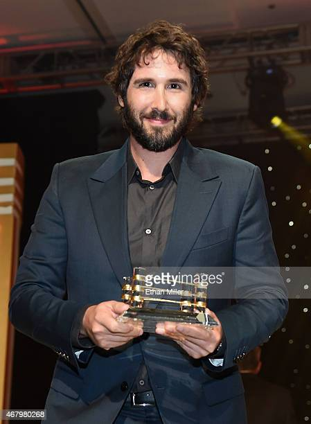 Honoree Josh Groban accepts an award onstage during Muhammad Ali's Celebrity Fight Night XXI at the Jw Marriott Phoenix Desert Ridge Resort Spa on...