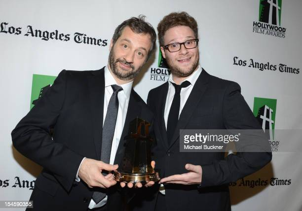 Honoree Judd Apatow and actor Seth Rogen pose with the Hollywood Comedy Award backstage at the 16th Annual Hollywood Film Awards Gala presented by...