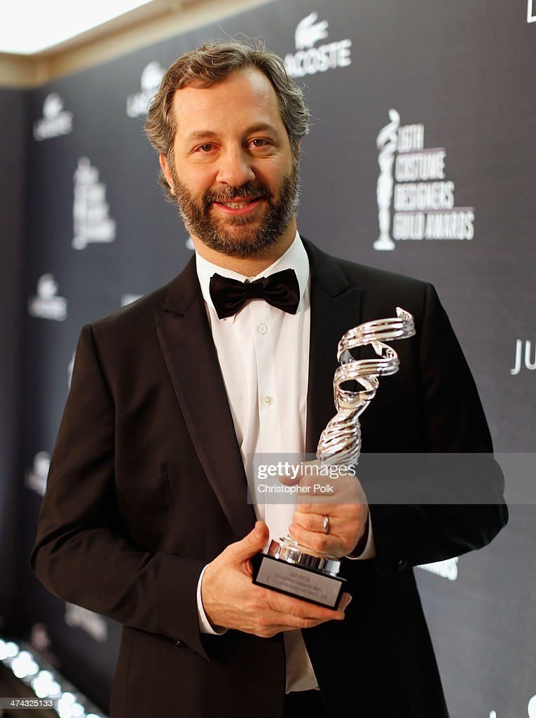 Honoree Judd Apatow poses with the Distinguished Collaborator award during the 16th Costume Designers Guild Awards with presenting sponsor Lacoste at The Beverly Hilton Hotel on February 22, 2014 in Beverly Hills, California.