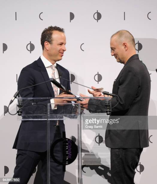 Honoree Juergen Teller accepts the Special Presentation Award from Executive director Mark Lubell onstage during the International Center Of...
