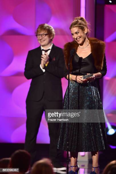Honoree Julie Greenwald accepts the Executive of the Year Award from Ed Sheeran onstage during Billboard Women In Music 2017 at The Ray Dolby...
