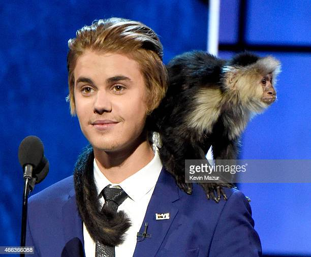 Honoree Justin Bieber and his monkey speak onstage at The Comedy Central Roast of Justin Bieber at Sony Pictures Studios on March 14, 2015 in Los...