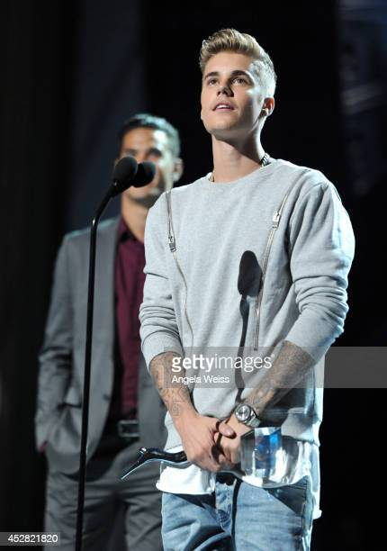 Honoree Justin Bieber speaks onstage at the 2014 Young Hollywood Awards brought to you by Samsung Galaxy at The Wiltern on July 27 2014 in Los...