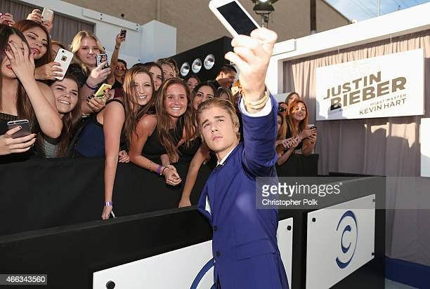 Honoree Justin Bieber takes a selfie with fans at The Comedy Central Roast of Justin Bieber at Sony Pictures Studios on March 14, 2015 in Los...