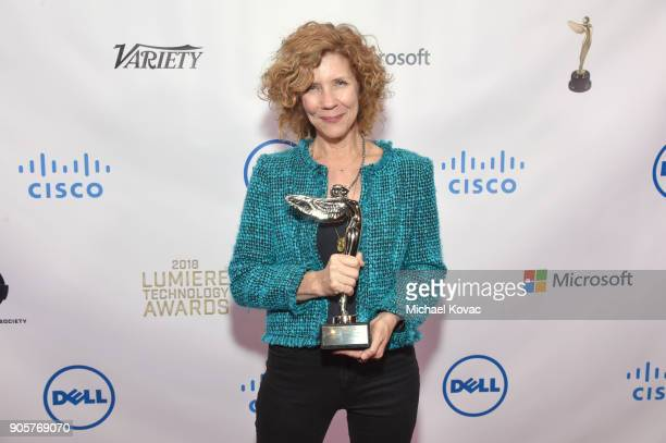 Honoree Karen DufilhoRosen poses with The Distinguished Leadership Award at the Advanced Imaging Society 2018 Lumiere Technology Awards Featuring The...