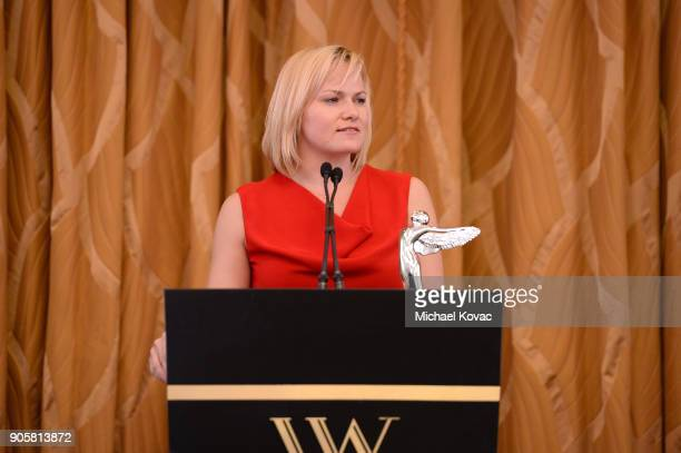 Honoree Kathleen Schroeter accepts the Distinguished Leadership Award onstage at the Advanced Imaging Society 2018 Lumiere Technology Awards...