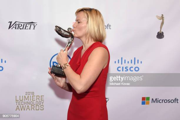 Honoree Kathleen Schroeter poses with the Distinguished Leadership Award at the Advanced Imaging Society 2018 Lumiere Technology Awards Featuring The...