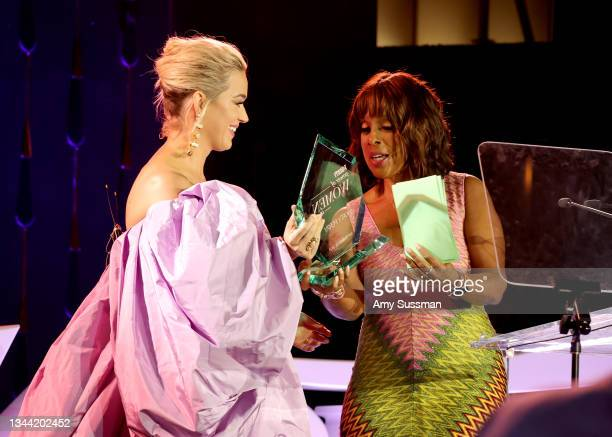 Honoree Katy Perry accepts an award from Gayle King onstage during Variety's Power of Women Presented by Lifetime at Wallis Annenberg Center for the...