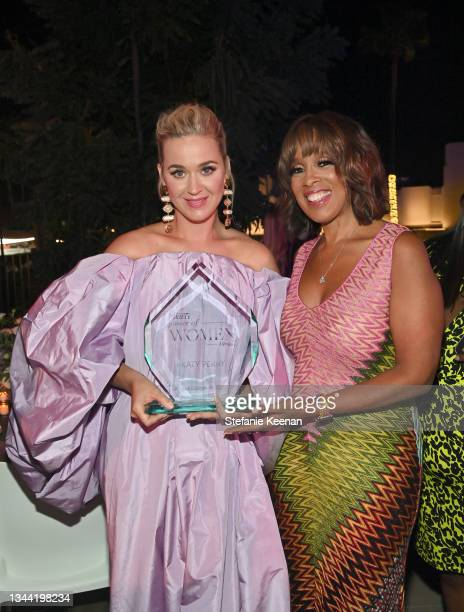 Honoree Katy Perry poses with an award alongside Gayle King during Variety's Power of Women Presented by Lifetime at Wallis Annenberg Center for the...