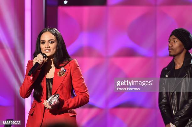 Honoree Kehlani accepts the Rule Breaker Award from Nick Cannon onstage during Billboard Women In Music 2017 at The Ray Dolby Ballroom at Hollywood...